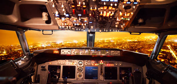 airplane cockpit and cityview - cockpit stock photos and pictures