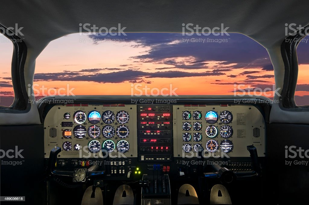 Airplane cockpit at sunset stock photo