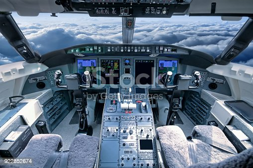 Airplane cockpit in flight, blue toned