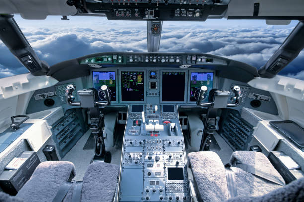 airplane cockpit in flight - cockpit stock photos and pictures