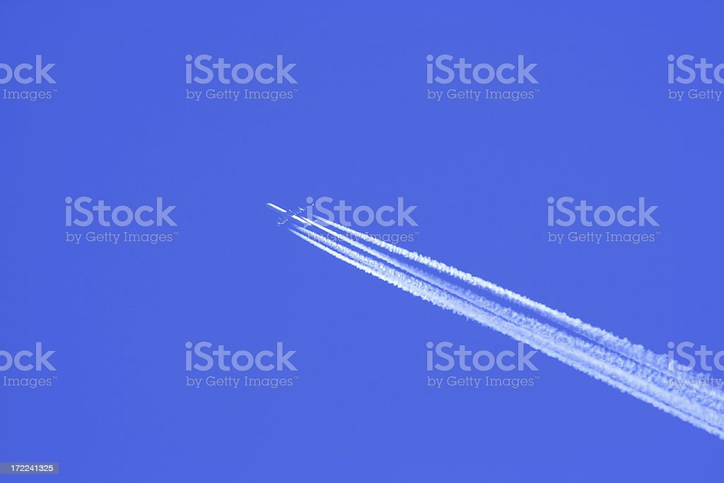 Airplane condensation trail royalty-free stock photo