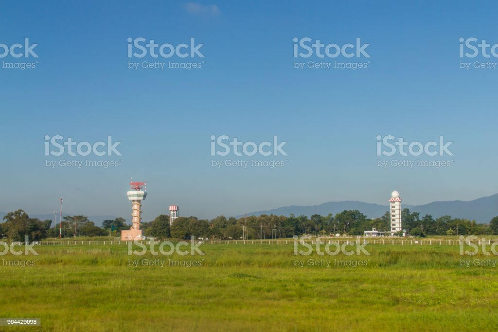 Airplane control tower on the green grass field with blue sky background at Chiang Rai International Airport, Thailand. - Royalty-free Airplane Stock Photo