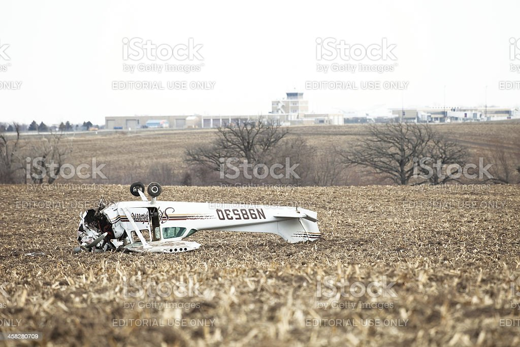 Airplane Crash on Farm Field with Airport Background stock photo