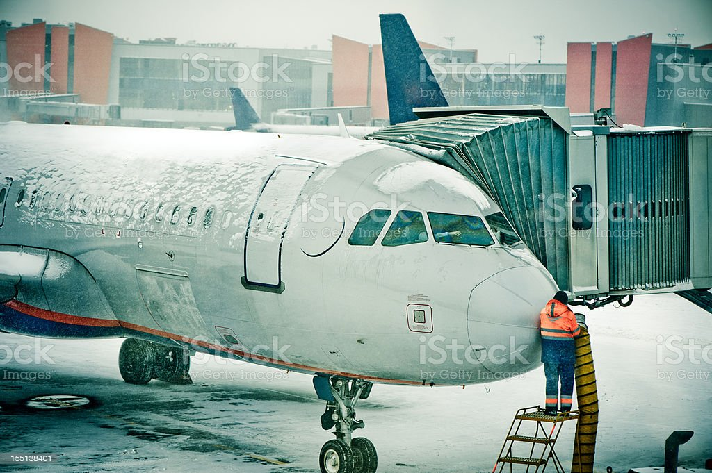 Airplane de-iced after snowstorm royalty-free stock photo