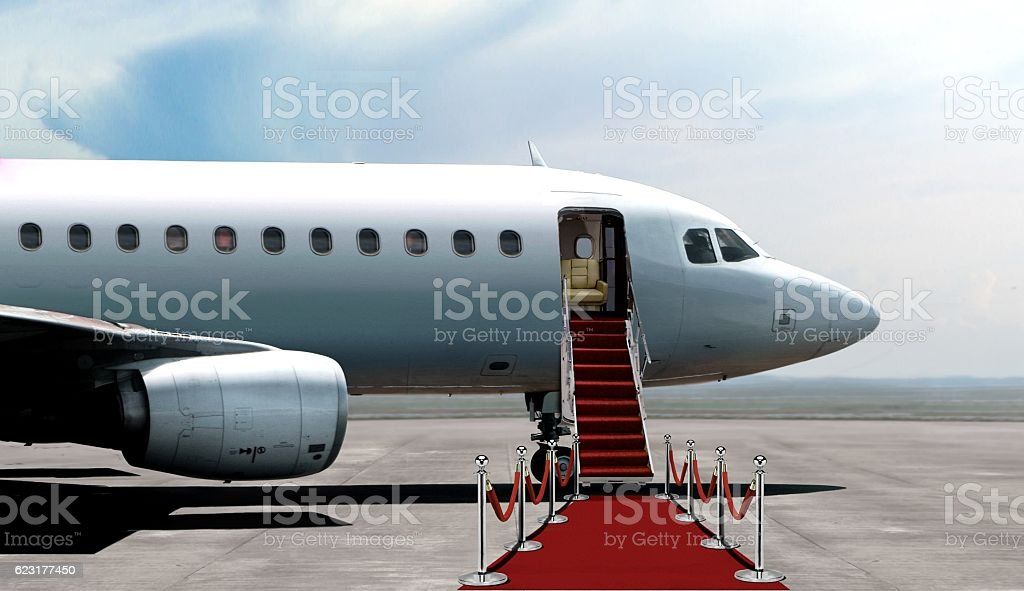 Airplane departure entrance with red carpet stock photo