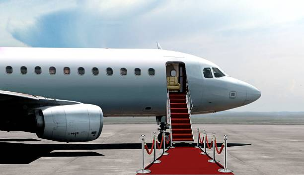 Airplane departure entrance with red carpet - foto de stock