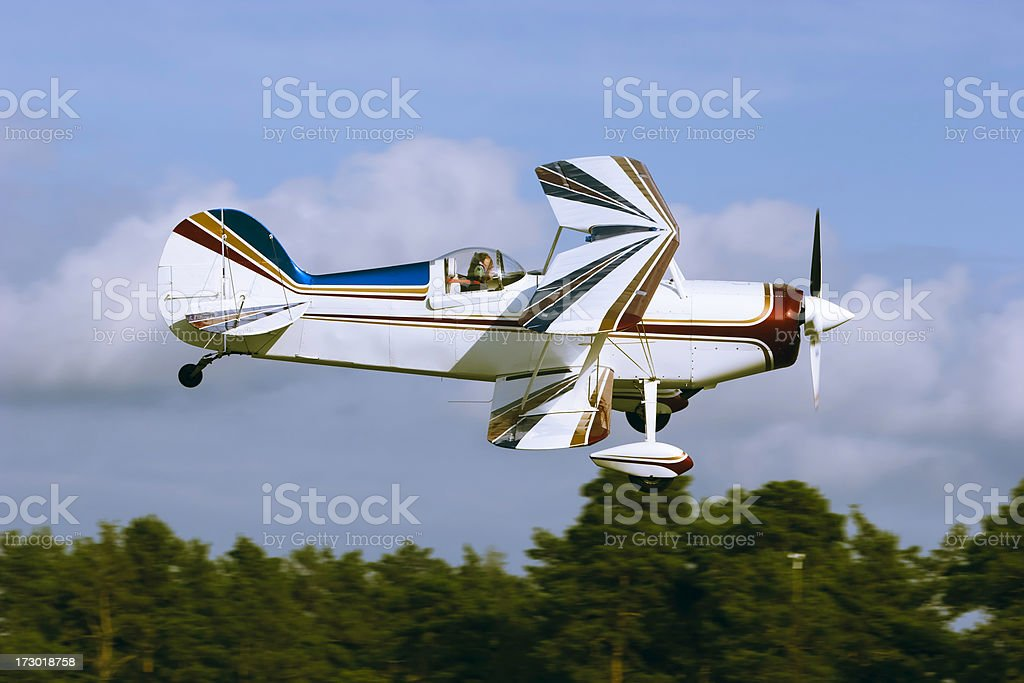 Airplane doing low fly by royalty-free stock photo