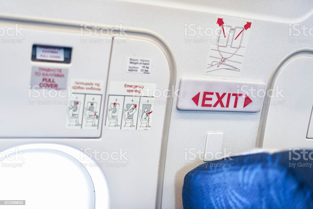 airplane emergency exit door stock photo