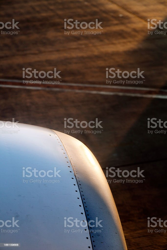 Airplane Engine nad Airport Asphalt at Dawn royalty-free stock photo