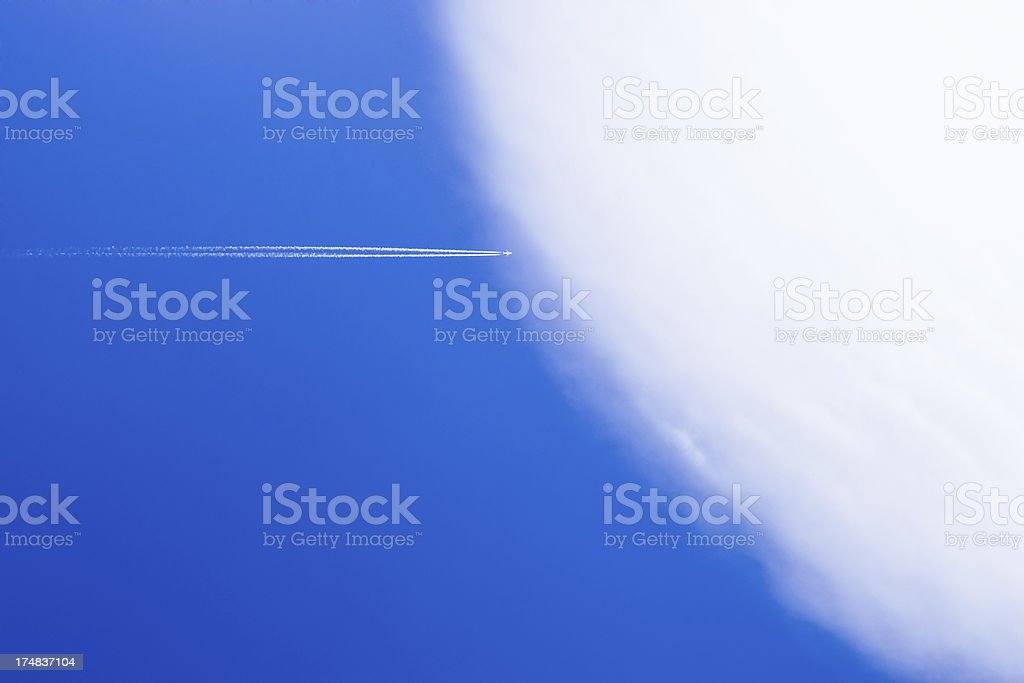 Airplane entering in one large circular cloud royalty-free stock photo
