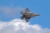 San Diego, California, USA - September 23,2017. F-35 Lightning stealth jet fighter flying a high speed banking turn at the 2017 Airshow in San Diego, California. The 2017 Miramar Airshow features aircraft flying and performing free to the general public.