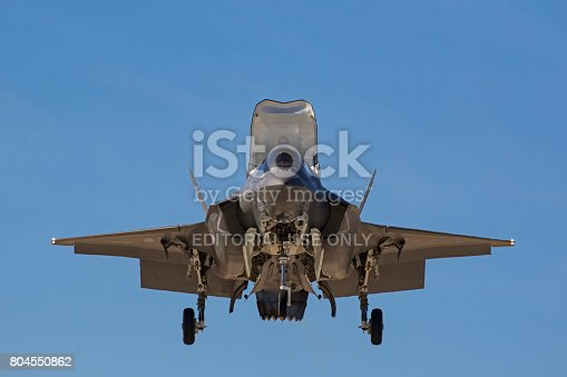 1145066973 istock photo Airplane F-35 Lightning stealth jet fighter vertical landing during air show 804550862