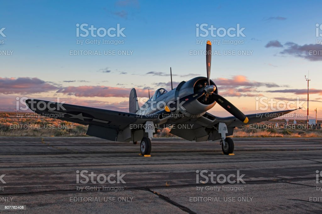 Airplane F4-U Corsair on the runway during sunrise at the air show stock photo