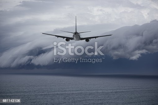 istock Airplane facing problem future: epic storm 681143106