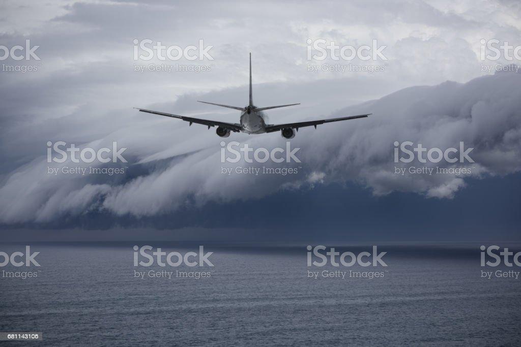 Airplane facing problem future: epic storm stock photo