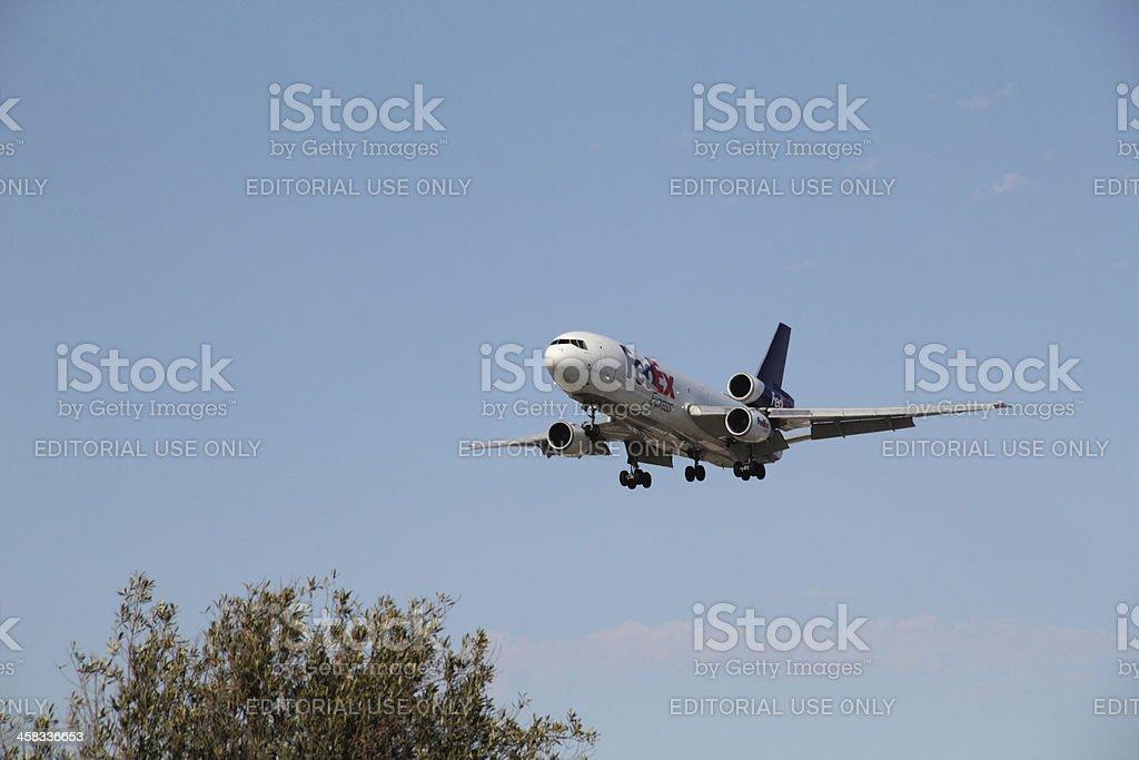 Airplane FedEx Express Landing Sky royalty-free stock photo