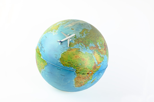 istock Airplane  flies around the  world 1092487954