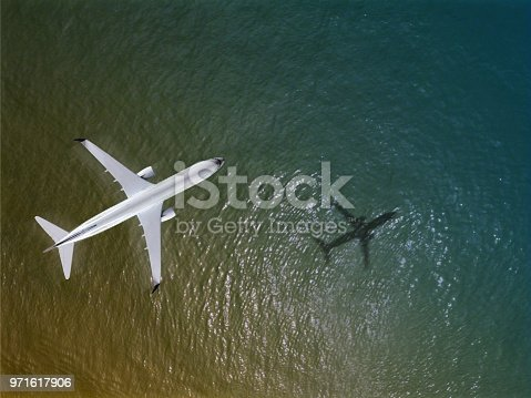 1058205304 istock photo Airplane flies over a sea, View from above 971617906