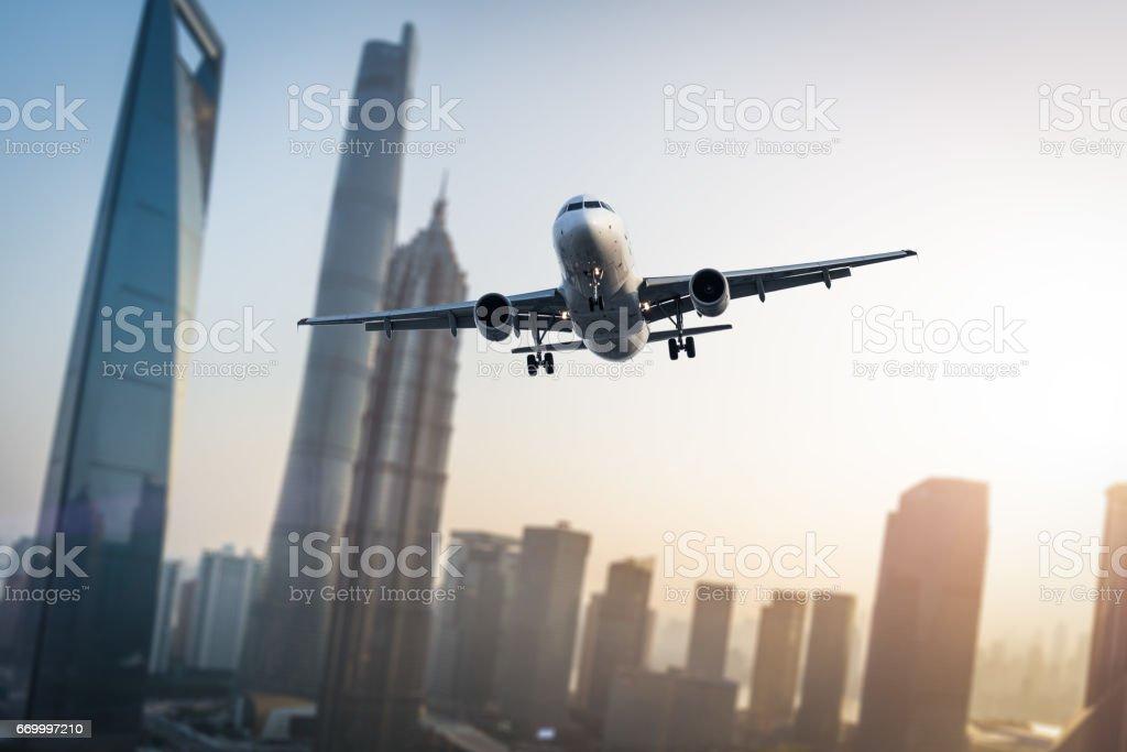 Airplane flies over city. stock photo