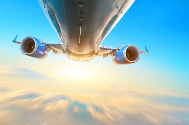 Airplane flies over the clouds in the sky. View of the fuselage, wings and engines, blurred effect motion light. Airplane flies over the clouds in the sky. View of the fuselage, wings and engines, blurred effect motion light supersonic airplane stock pictures, royalty-free photos & images