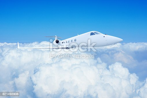 943681768 istock photo Airplane Flight in Blue Sky 621493906