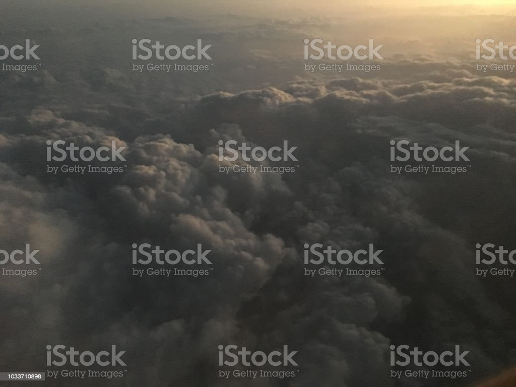 Airplane flight in sky above clouds