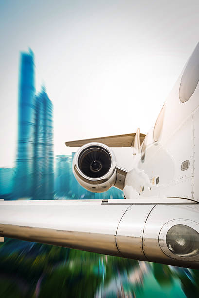 Airplane fly above city motion a moving airplane fly over city. aboveboard stock pictures, royalty-free photos & images