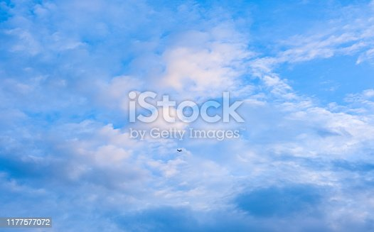 479184640istockphoto airplane fly on blue sky white fluffy cloud 1177577072