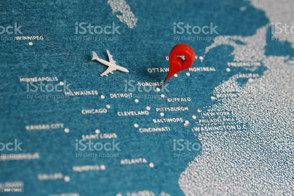 airplane fly on the blue felt painted map, north america stock photo