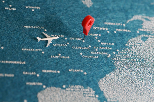airplane fly on the blue felt painted map stock photo
