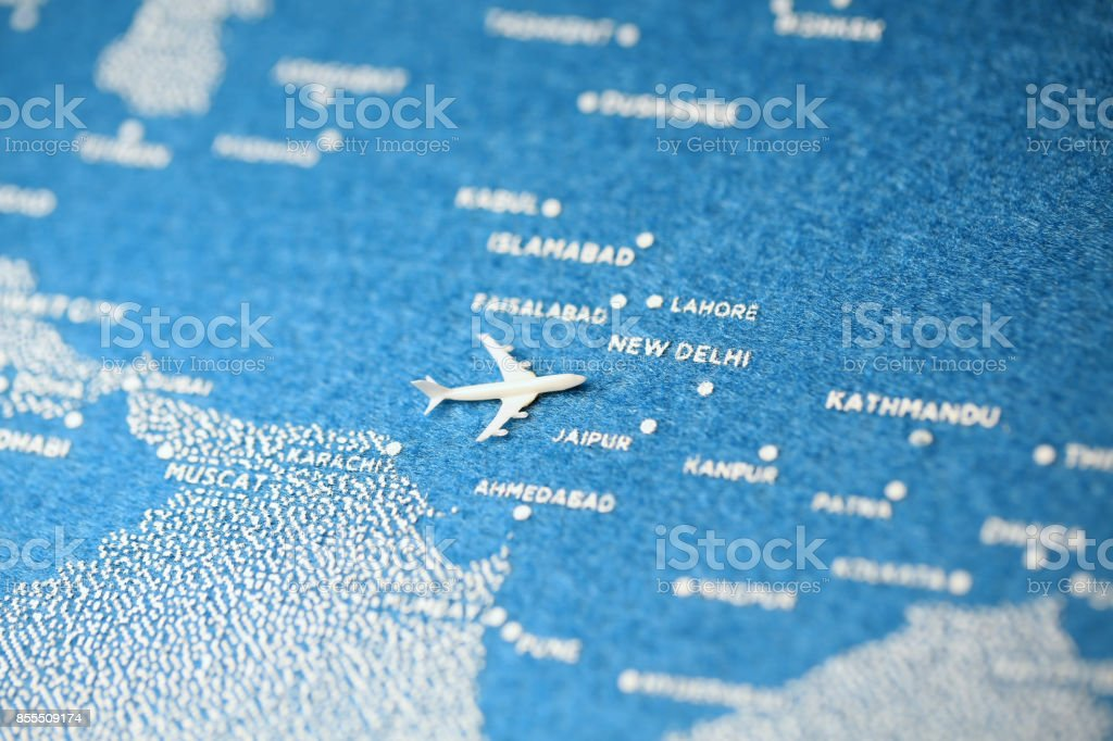 airplane fly on the blue painted map new delhi stock photo