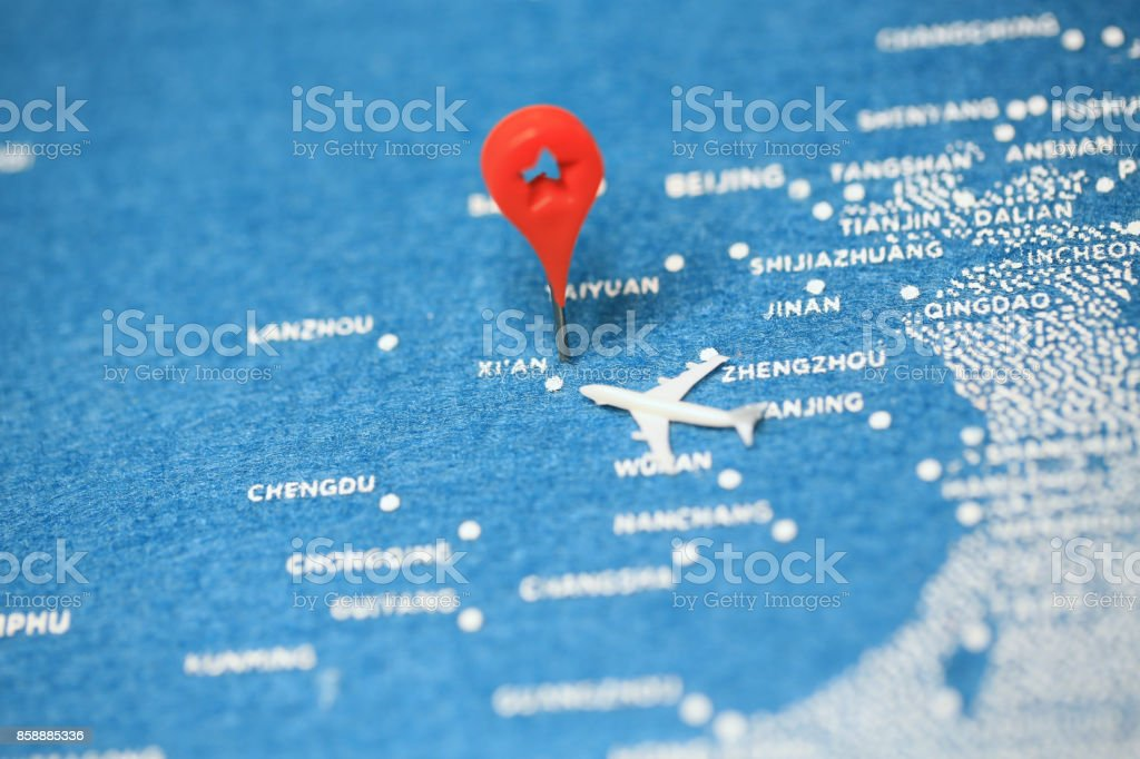 airplane fly on the blue painted map stock photo