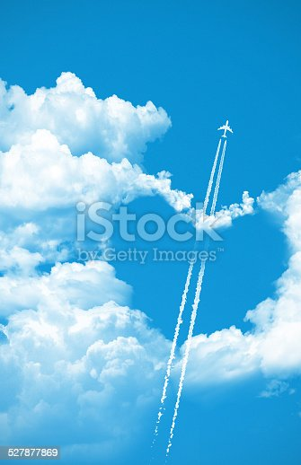istock Airplane fly over a heart on the sky 527877869