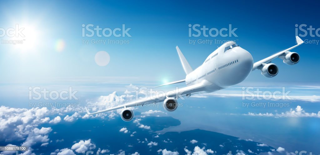 Airplane flying above clouds foto stock royalty-free