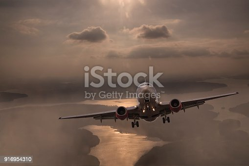 155439315istockphoto Airplane flying above clouds 916954310