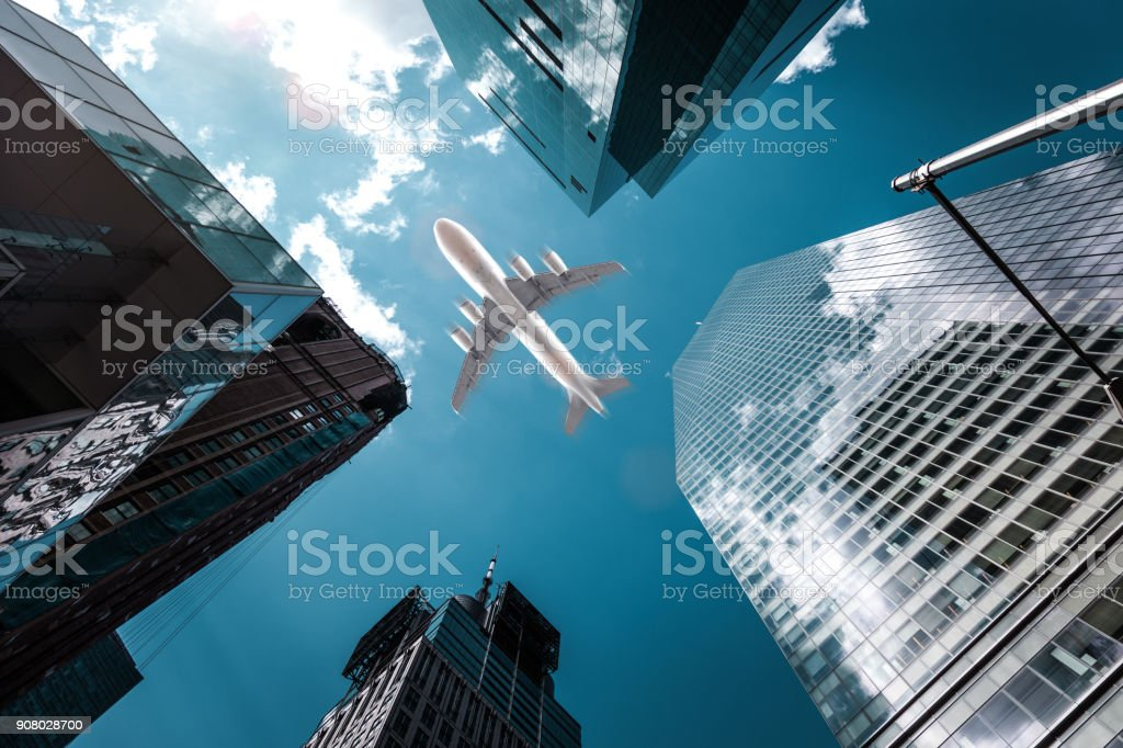 Airplane flying above downtown skyscrapers in New York City stock photo