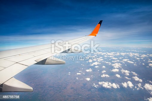 istock airplane flying above the clouds in the sky 485755758