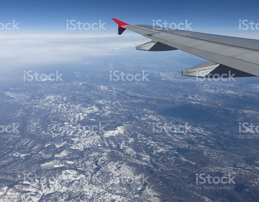 Airplane Flying above the Clouds royalty-free stock photo