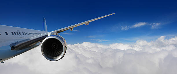 Airplane Flying above the Clouds stock photo