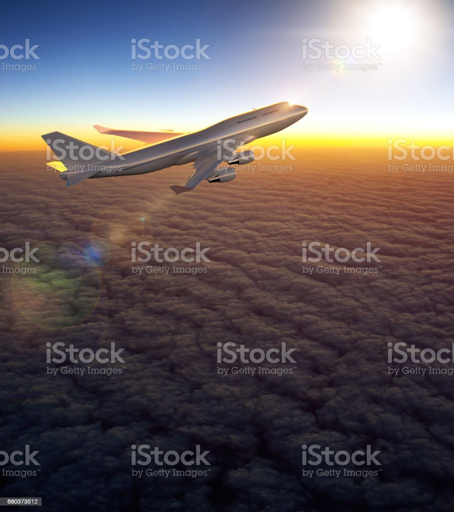 Airplane flying during sunset royalty-free stock photo