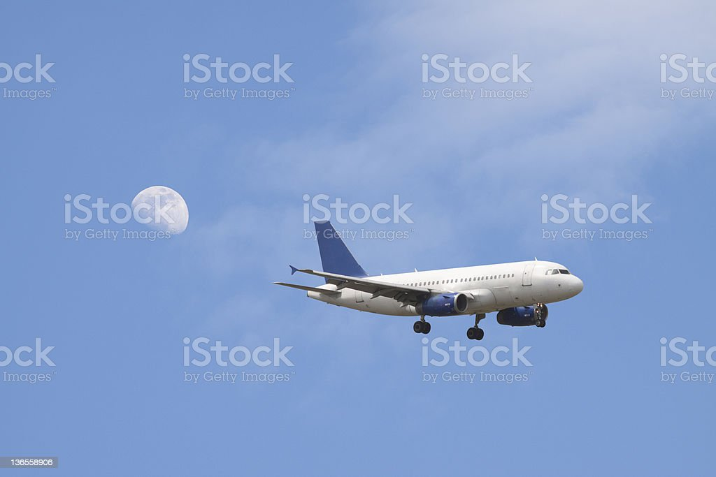Airplane Flying in a Blue Sky, Mid Air Position stock photo