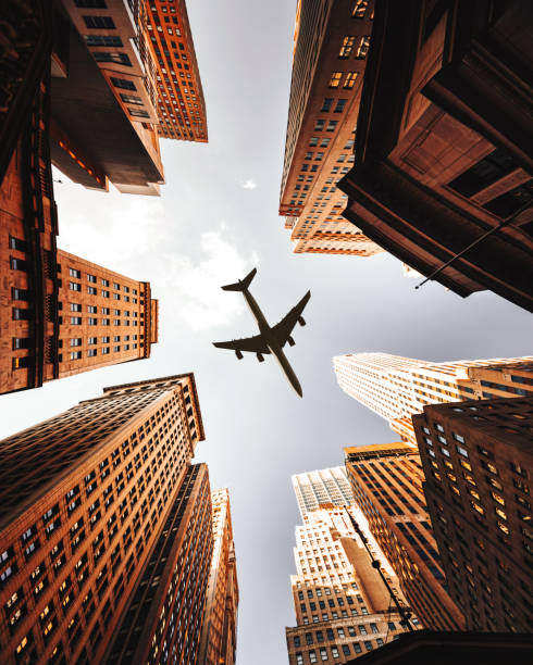 airplane flying in nyc stock photo