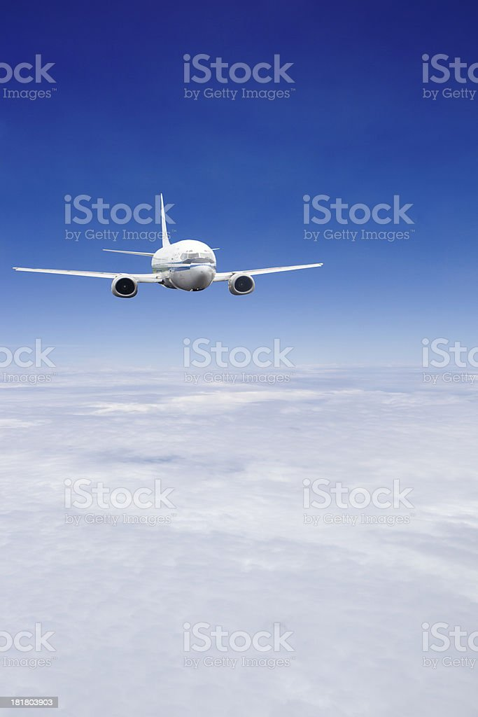 airplane flying in the blue sky royalty-free stock photo