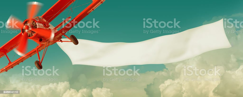 Airplane flying in the sky with a  banner royalty-free stock photo