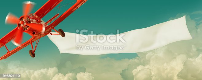 istock Airplane flying in the sky with a  banner 946804110