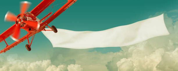 Airplane flying in the sky with a  banner stock photo