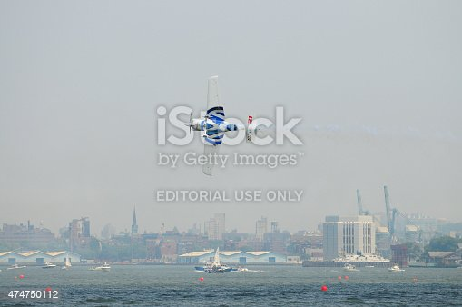 istock Airplane flying low in New York City. 474750112