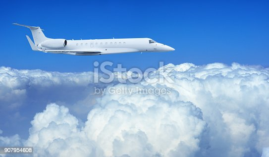 943681768 istock photo Airplane Flying on the Cloud 907954608