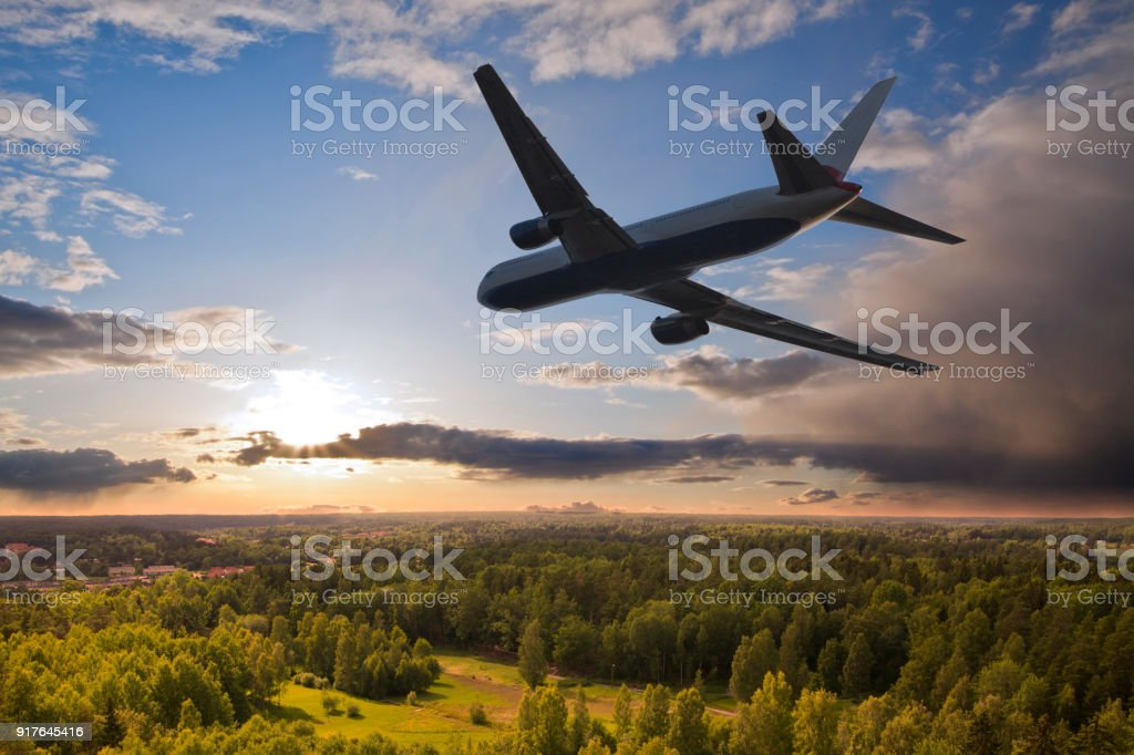 Airplane flying over a forest stock photo