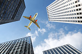 Airplane flying over buildings in New York City